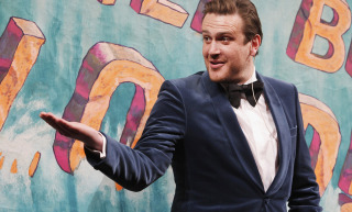 Actor Jason Segel gestures to Hasty Pudding Theatricals cast members as he is honoured as the